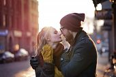 foto of heterosexual couple  - Young happy couple hugging on the city street