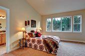 picture of master bedroom  - Ivory master bedroom with open door to bathroom - JPG