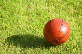 image of netball  - close up dirty basketball focus on dirty small basketball size 3 on the grass to show used of the ball - JPG