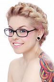 stock photo of freaky  - Portrait of young beautiful smiling freaky girl in glasses over white background - JPG
