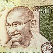 foto of gandhi  - A closeup of Gandhi on a five hundred rupee note - JPG