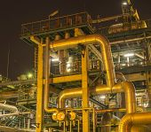 stock photo of refinery  - Refinery industrial plant with Industry boiler at night - JPG