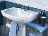 stock photo of sink  - detail of a modern bathroom with sink and accessories bathroom cabinet and blye bathroom tiles - JPG