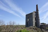 pic of derelict  - Old derelict Cornish Tin Mine and chimney in Cornwall England - JPG