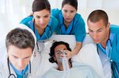 stock photo of cpr  - Emergency team carrying a patient - JPG