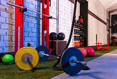 stock photo of barbell  - Barbells in a gym bar bells and rope at cross fit - JPG