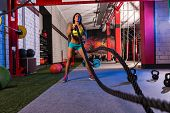 image of roping  - battling ropes girl at gym workout exercise fitted body - JPG