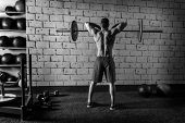 stock photo of lifting weight  - Barbell weight lifting man rear view workout gym weightlifting - JPG