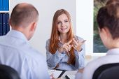 foto of conversation  - Young clever woman during her job conversation - JPG