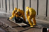 picture of decontamination  - Man in chemical protection suit carrying out the decontamination area