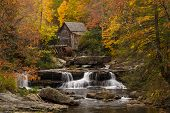 pic of virginia  - The vibrant colors of Autumn surround the old grist mill at Babcock State Park in West Virginia - JPG