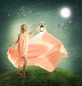 pic of hilltop  - Young woman on a fantasy grassy hilltop with antique lamp - JPG