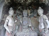 image of cave  - Buddha and two guards are enshrined in a cave of Mountain Maiji Grottoes - JPG