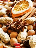 stock photo of christmas spices  - Christmas background made of nuts dried oranges and spices - JPG