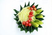 foto of papaya  - The prepare set for papaya salad there are sliced papaya paprika cucumber tomato and eggplant - JPG