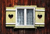 pic of woodcarving  - vintage window in a small German village - JPG