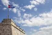 stock photo of el morro castle  - Cuban flag flying on the top of the  - JPG