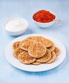 pic of buckwheat  - Buckwheat blini with red caviar and sour cream on white plate selective focus - JPG