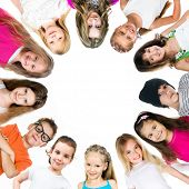 image of huddle  - Group of smiling kids standing in huddle on white background - JPG