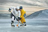 foto of ice hockey goal  - Ice hockey players on the ice in mountains - JPG