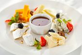 foto of dipping  - Cheese Plate with Honey Dip and Fresh Berries - JPG