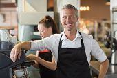 foto of cafe  - Barista smiling at the camera at the cafe - JPG