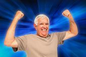 picture of clenched fist  - Portrait of a cheerful senior man with clenched fists against abstract background - JPG