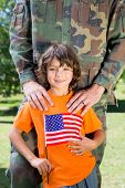 picture of reunited  - Soldier reunited with his son on a sunny day - JPG