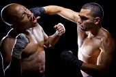 pic of sparring  - sparring mma fighters or boxers punching each other - JPG