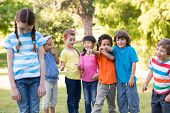 pic of bullying  - Little girl being bullied in park on a sunny day - JPG