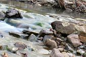 stock photo of h20  - Creek in the woods with a decline including rocks - JPG