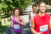 foto of friendship day  - Fit people running race in park on a sunny day - JPG