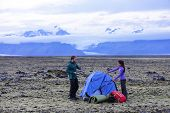 pic of tent  - Camping couple pitching tent after hiking - JPG