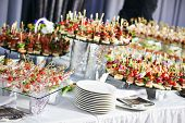 stock photo of gourmet food  - catering services background with snacks on guests table in restaurant at event party - JPG