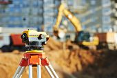 foto of engineering construction  - Surveyor equipment tacheometer or theodolite outdoors at construction site - JPG