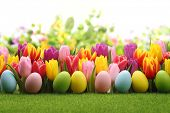 foto of easter flowers  - Easter eggs decorated with flowers on meadow - JPG
