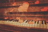 foto of heart sounds  - Piano with red paper hearts - JPG