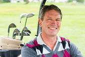 picture of buggy  - Happy golfer driving his golf buggy smiling at camera on a sunny day at the golf course - JPG