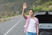 pic of breakdown  - Man waving after a breakdown at the side of the road - JPG