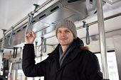 foto of tram  - Man in winter clothes in a tram in Kazan - JPG