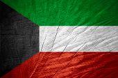 image of kuwait  - Kuwait flag or Kuwaiti banner on wooden texture - JPG