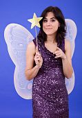 image of tinkerbell  - young beautiful woman dressed as tinkerbell studio picture - JPG