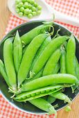 stock photo of peas  - green peas on the wooden table - JPG