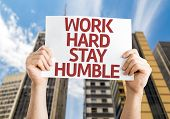 stock photo of humble  - Work Hard Stay Humble card with urban background - JPG