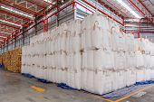 stock photo of sugar industry  - Warehouse with stacked big sacks of meal - JPG