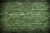 stock photo of green wall  - Close up of a Green Worn Brick wall - JPG