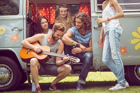 picture of camper  - Hipster friends in camper van at festival on a summers day - JPG