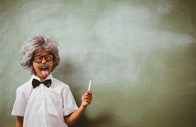 foto of half-dressed  - Portrait of little boy dressed as senior teacher in front of blackboard - JPG