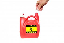 picture of bio-hazard  - A home made Needle and Sharps Disposal Container made from an old laundry soap dispenser - JPG