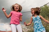 picture of bounce house  - Small cute children jumping on trampoline  - JPG